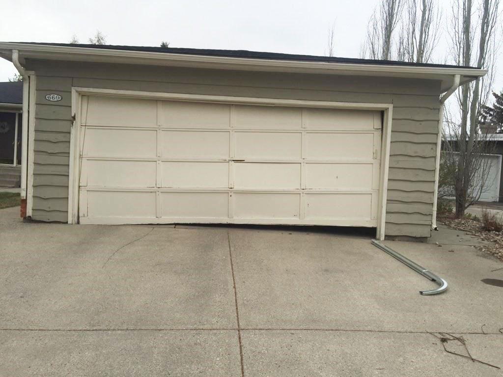 broken bent garage door