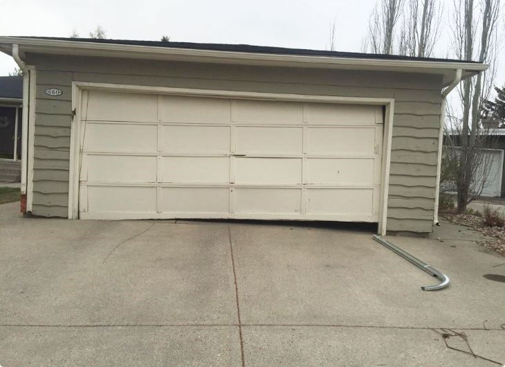damaged garage door needing maintenance